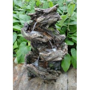 Vernier waterornament waterornament vernier bestaande uit een boomstronk in natuurlook. de fontein is ...